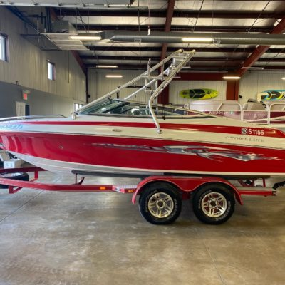 a red and white boat in a garage